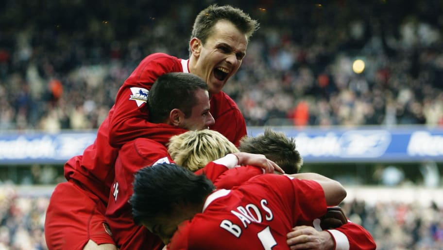 LIVERPOOL, ENGLAND - MARCH 20: Dietmar Hamann of Liverpool celerbates with team mates following a goal by Sami Hyypia during the FA Barclaycard Premiership match between Liverpool and Wolverhampton Wanderers at Anfield on March 20, 2004 in Liverpool, England.  (Photo by Gary M.Prior/Getty Images)