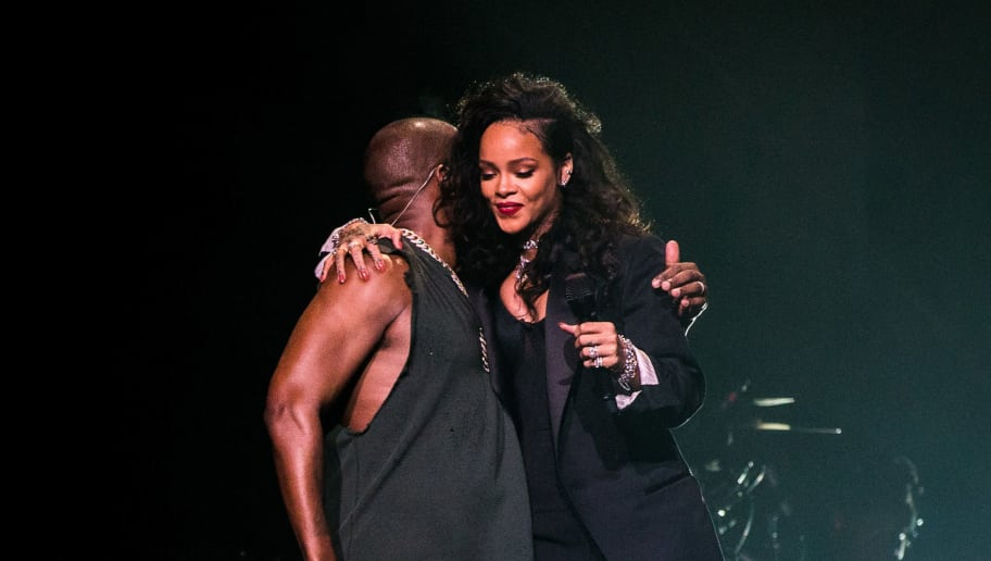 GLENDALE, AZ - JANUARY 31:  Recording artists Kanye West (L) and Rihanna perform onstage during DirecTV Super Saturday Night hosted by Mark Cuban's AXS TV and Pro Football Hall of Famer Michael Strahan at Pendergast Family Farm on January 31, 2015 in Glendale, Arizona.  (Photo by Christopher Polk/Getty Images for DirecTV)