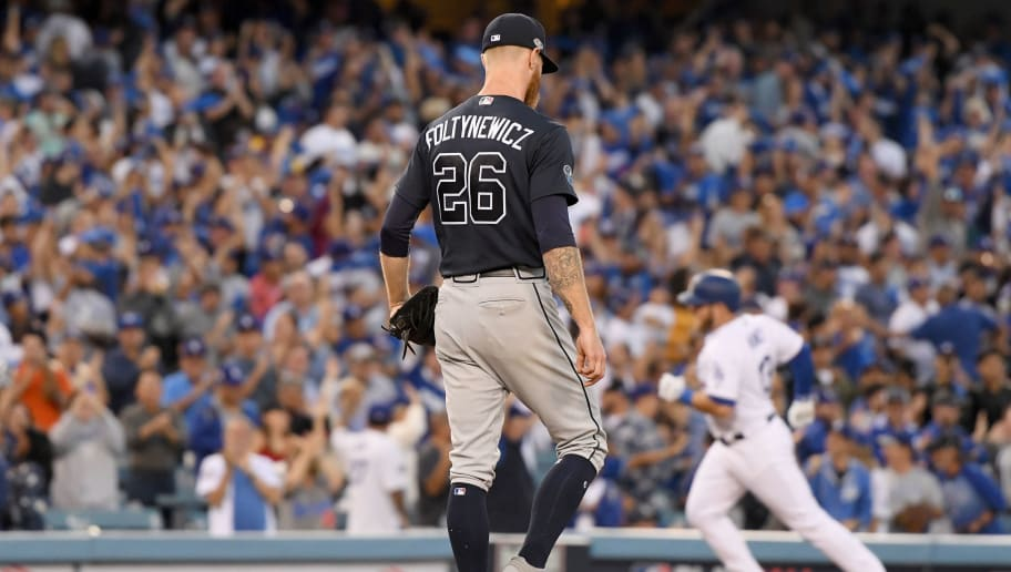 LOS ANGELES, CA - OCTOBER 04:  Mike Foltynewicz #26 of the Atlanta Braves reacts as Max Muncy #13 of the Los Angeles Dodgers rounds the bases after his second inning three run home run during Game One of the National League Division Series at Dodger Stadium on October 4, 2018 in Los Angeles, California.  (Photo by Harry How/Getty Images)