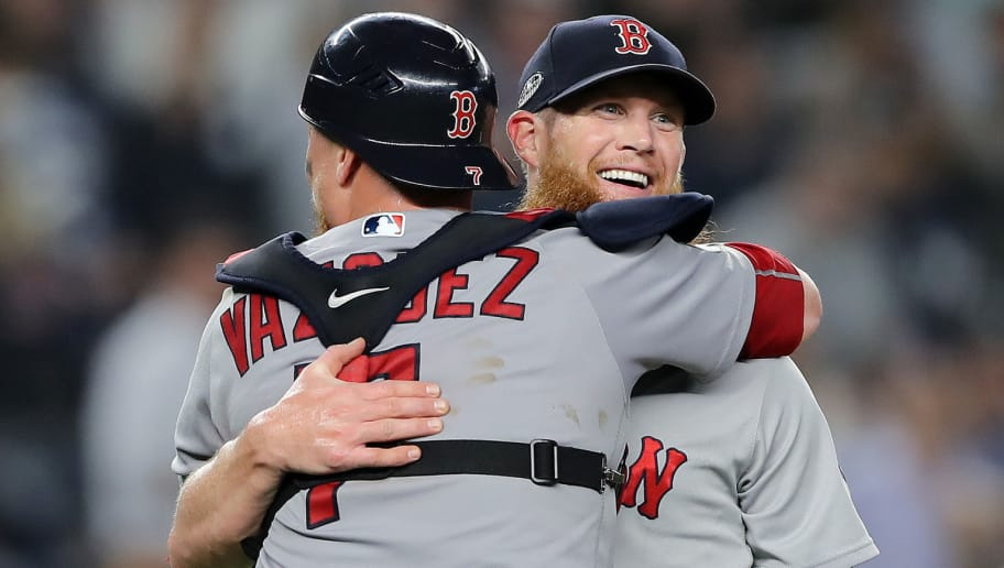 NEW YORK, NEW YORK - OCTOBER 09:  Craig Kimbrel #46 and Christian Vazquez #7 of the Boston Red Sox celebrate after beating the New York Yankees by a score of 4-3 to win Game Four American League Division Series at Yankee Stadium on October 09, 2018 in the Bronx borough of New York City. (Photo by Elsa/Getty Images)