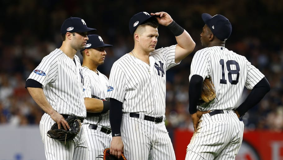 NEW YORK, NEW YORK - OCTOBER 09:  Luke Voit #45 and Didi Gregorius #18 of the New York Yankees talk against the Boston Red Sox during the seventh inning in Game Four of the American League Division Series at Yankee Stadium on October 09, 2018 in the Bronx borough of New York City. (Photo by Mike Stobe/Getty Images)