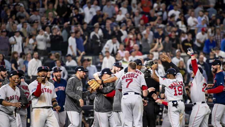 NEW YORK, NY - OCTOBER 9: Members of the Boston Red Sox celebrate after clinching the American League Division Series in game four against the New York Yankees on October 9, 2018 at Yankee Stadium in the Bronx borough of New York City. (Photo by Billie Weiss/Boston Red Sox/Getty Images)