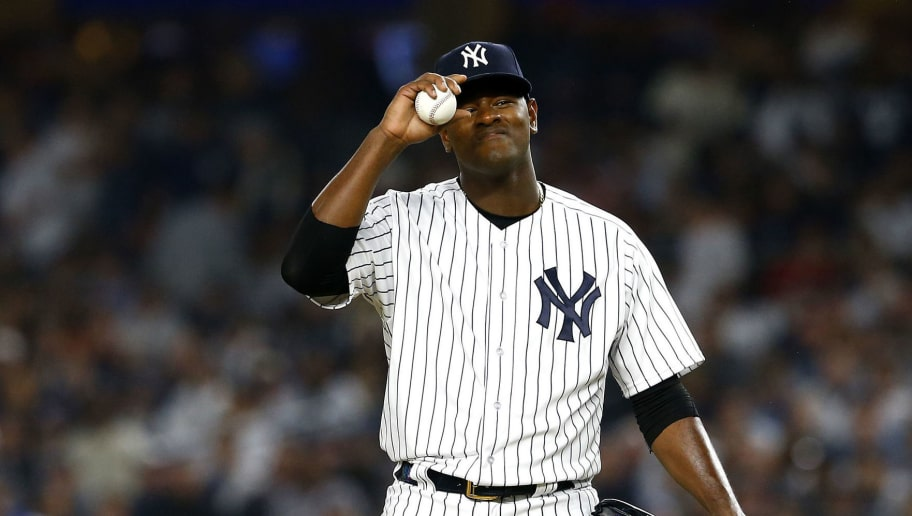 NEW YORK, NEW YORK - OCTOBER 08:   Luis Severino #40 of the New York Yankees reacts against the Boston Red Sox during the second inning in Game Three of the American League Division Series at Yankee Stadium on October 08, 2018 in the Bronx borough of New York City. (Photo by Mike Stobe/Getty Images)