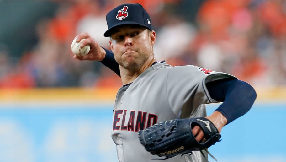 HOUSTON, TX - OCTOBER 05:  Corey Kluber #28 of the Cleveland Indians delivers a pitch in the second inning against the Houston Astros during Game One of the American League Division Series at Minute Maid Park on October 5, 2018 in Houston, Texas.  (Photo by Tim Warner/Getty Images)