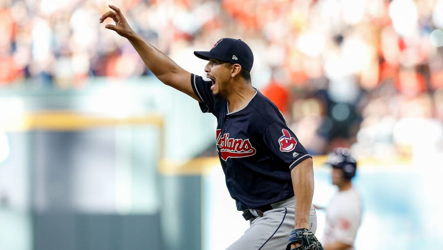 HOUSTON, TX - OCTOBER 06:  Carlos Carrasco #59 of the Cleveland Indians reacts against the Houston Astros in the sixth inning during Game Two of the American League Division Series at Minute Maid Park on October 6, 2018 in Houston, Texas.  (Photo by Tim Warner/Getty Images)