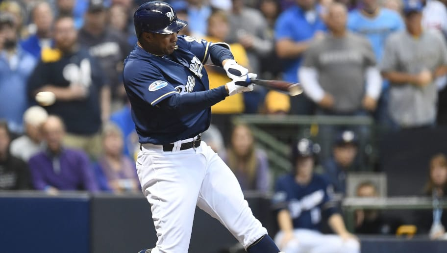MILWAUKEE, WI - OCTOBER 05:  Jonathan Schoop #5 of the Milwaukee Brewers at bat during Game Two of the National League Divisional Series against the Colorado Rockies at Miller Park on October 5, 2018 in Milwaukee, Wisconsin.  The Brewers defeated the Rockies 4-0.  (Photo by Stacy Revere/Getty Images)