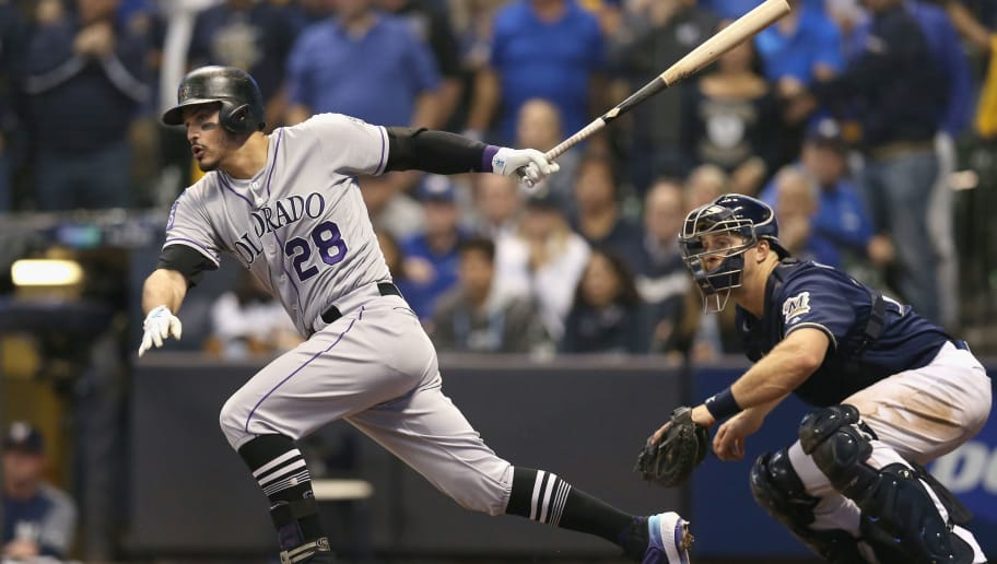 MILWAUKEE, WI - OCTOBER 05:  Nolan Arenado #28 of the Colorado Rockies hits a single in the eighth inning of Game Two of the National League Division Series against the Milwaukee Brewers at Miller Park on October 5, 2018 in Milwaukee, Wisconsin.  (Photo by Dylan Buell/Getty Images)