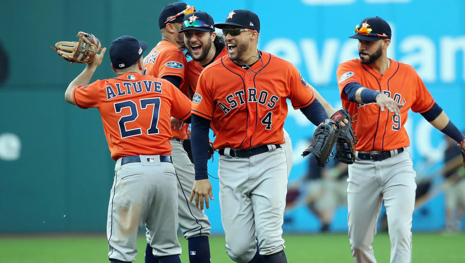 CLEVELAND, OH - OCTOBER 08:  George Springer #4 of the Houston Astros celebrates with teammates after defeating the Cleveland Indians 11-3 in Game Three of the American League Division Series to advance to the American League Championship Series at Progressive Field on October 8, 2018 in Cleveland, Ohio.  (Photo by Gregory Shamus/Getty Images)