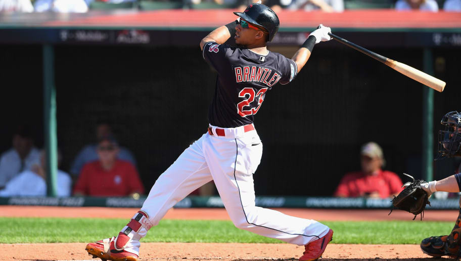CLEVELAND, OH - OCTOBER 08:  Michael Brantley #23 of the Cleveland Indians hits a sacrifice fly ball in the third inning to score Yan Gomes #7 (not pictured) against the Houston Astros during Game Three of the American League Division Series at Progressive Field on October 8, 2018 in Cleveland, Ohio.  (Photo by Jason Miller/Getty Images)