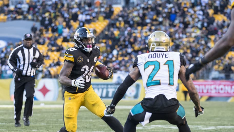 PITTSBURGH, PA - JANUARY 14:  Le'Veon Bell #26 of the Pittsburgh Steelers carries a ball lateraled by Ben Roethlisberger #7 for a touchdown during the second half of the AFC Divisional Playoff game against the Jacksonville Jaguars at Heinz Field on January 14, 2018 in Pittsburgh, Pennsylvania. Jaguars defeat Pittsburgh 45-42.  (Photo by Brett Carlsen/Getty Images)