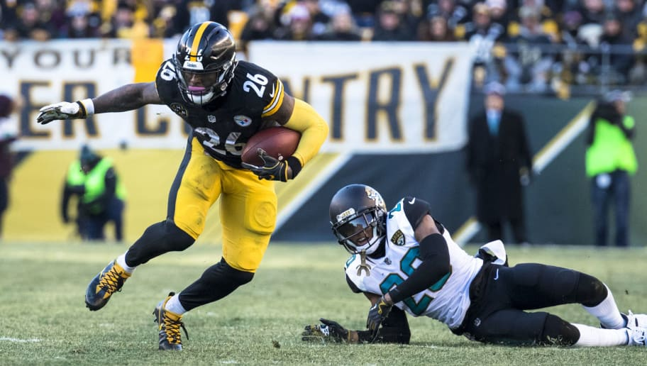 PITTSBURGH, PA - JANUARY 14:  Le'Veon Bell #26 of the Pittsburgh Steelers runs with the ball during the second half of the AFC Divisional Playoff game against the Jacksonville Jaguars at Heinz Field on January 14, 2018 in Pittsburgh, Pennsylvania. Jaguars defeat Pittsburgh 45-42.  (Photo by Brett Carlsen/Getty Images)
