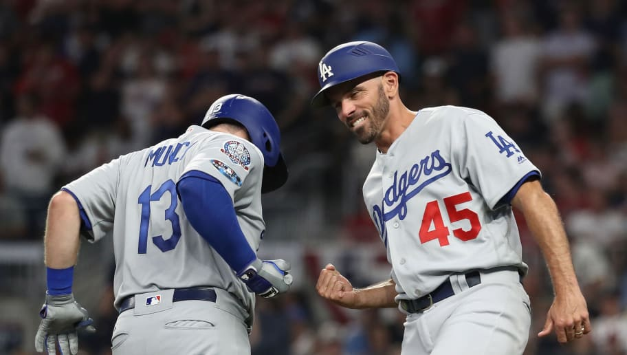 ATLANTA, GA - OCTOBER 07:  Max Muncy #13 of the Los Angeles Dodgers celebrates with third base coach Chris Woodward #45 after hitting a solo home run in the fifth inning against the Atlanta Braves during Game Three of the National League Division Series at SunTrust Park on October 7, 2018 in Atlanta, Georgia.  (Photo by Rob Carr/Getty Images)