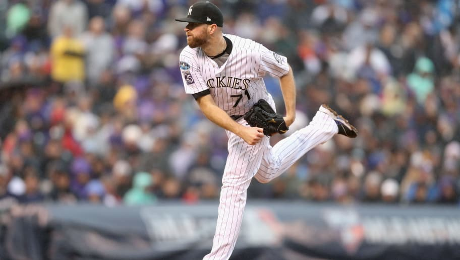 DENVER, CO - OCTOBER 07:  Wade Davis #71 of the Colorado Rockies pitches in the ninth inning of Game Three of the National League Division Series against the Milwaukee Brewers at Coors Field on October 7, 2018 in Denver, Colorado.  (Photo by Matthew Stockman/Getty Images)
