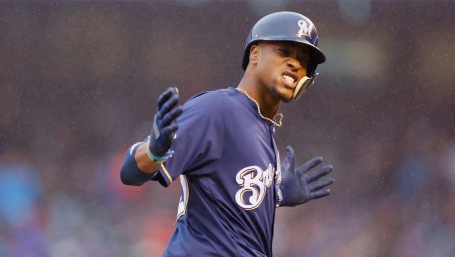 DENVER, CO - OCTOBER 07:  Keon Broxton #23 of the Milwaukee Brewers celebrates after hitting a solo homerun in the ninth inning of Game Three of the National League Division Series off outfield Wade Davis #71 of the Colorado Rockies at Coors Field on October 7, 2018 in Denver, Colorado.  (Photo by Justin Edmonds/Getty Images)
