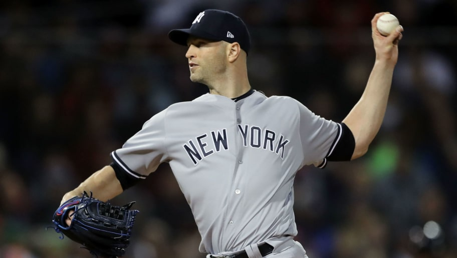 BOSTON, MA - OCTOBER 05:  J.A. Happ #34 of the New York Yankees delivers a pitch in the first inning of Game One of the American League Division Series against the Boston Red Sox at Fenway Park on October 5, 2018 in Boston, Massachusetts.  (Photo by Elsa/Getty Images)