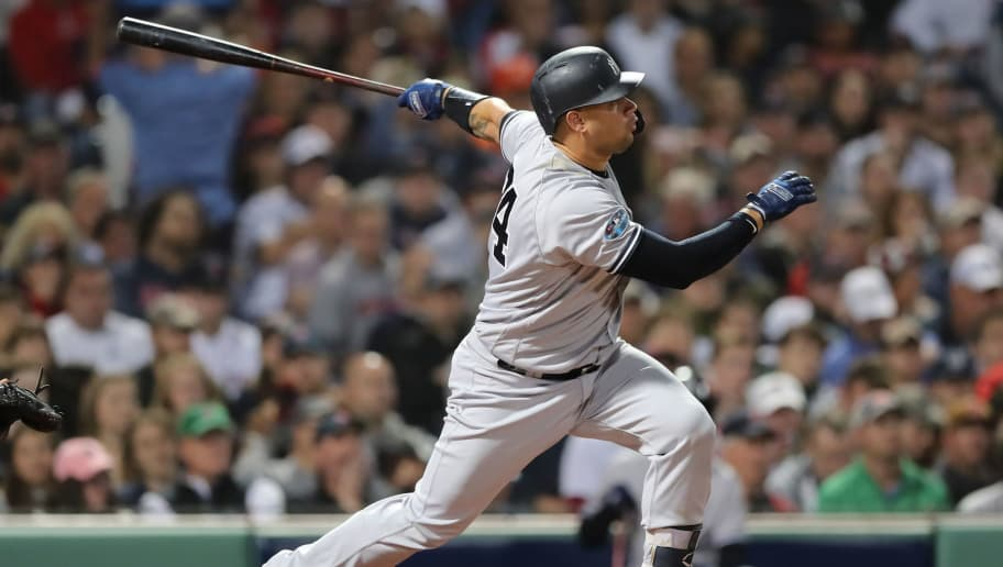 BOSTON, MA - OCTOBER 06:  Gary Sanchez #24 of the New York Yankees hits a solo home run to left field during Game Two of the American League Division Series against the Boston Red Sox at Fenway Park on October 6, 2018 in Boston, Massachusetts  (Photo by Elsa/Getty Images)