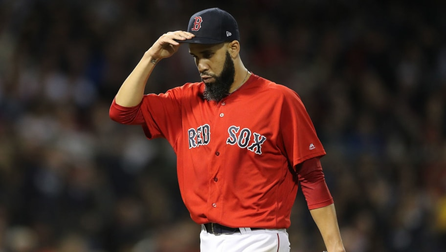 BOSTON, MA - OCTOBER 06:  Pitcher David Price #24 of the Boston Red Sox walks back to the dugout after being pulled from the game in the second inning of Game Two of the American League Division Series against the New York Yankees  at Fenway Park on October 6, 2018 in Boston, Massachusetts.  (Photo by Elsa/Getty Images)
