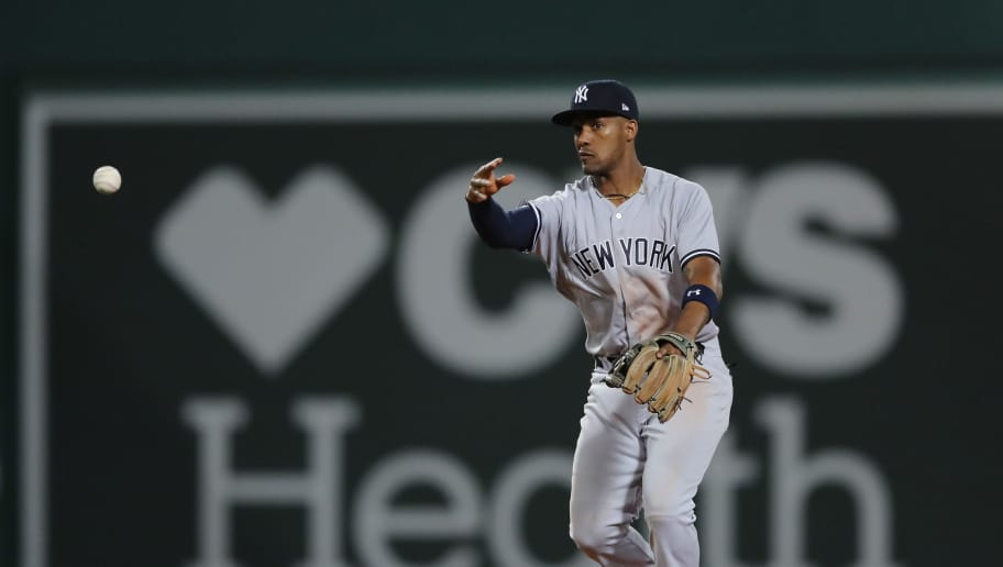BOSTON, MA - OCTOBER 06:  Miguel Andujar #41 of the New York Yankees throws to first base for the out in the fifth inning during Game Two of the American League Division Series against the Boston Red Sox at Fenway Park on October 6, 2018 in Boston, Massachusetts.  (Photo by Elsa/Getty Images)