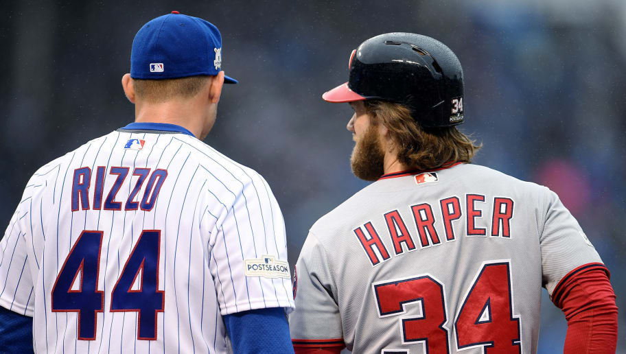 CHICAGO, IL - OCTOBER 11:  Anthony Rizzo #44 of the Chicago Cubs and Bryce Harper #34 of the Washington Nationals meet in the first inning during game four of the National League Division Series at Wrigley Field on October 11, 2017 in Chicago, Illinois. (Photo by Stacy Revere/Getty Images)