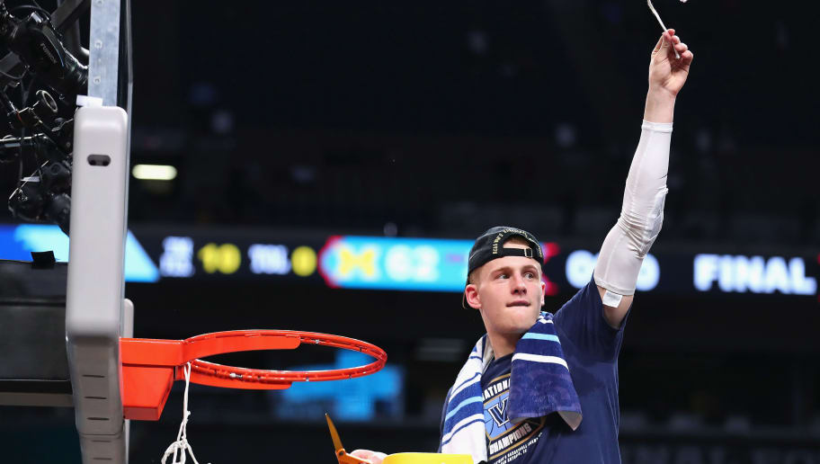 SAN ANTONIO, TX - APRIL 02: Donte DiVincenzo #10 of the Villanova Wildcats cuts down the net after defeating the Michigan Wolverines during the 2018 NCAA Men's Final Four National Championship game at the Alamodome on April 2, 2018 in San Antonio, Texas. Villanova defeated Michigan 79-62.  (Photo by Tom Pennington/Getty Images)