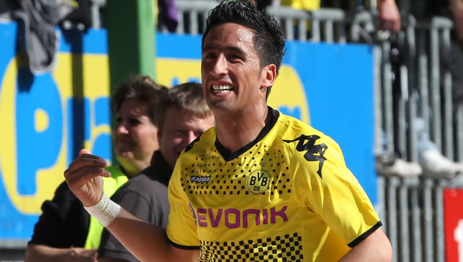 Dortmund's Argentinian striker Lucas Barrios celebrates after scoring the 4-2 during the German first division Bundesliga football match 1.FC Kaiserslautern vs Borussia Dortmund in Kaiserslautern, Germany, on April 28, 2012. AFP PHOTO / DANIEL ROLAND  RESTRICTIONS / EMBARGO - DFL LIMITS THE USE OF IMAGES ON THE INTERNET TO 15 PICTURES (NO VIDEO-LIKE SEQUENCES) DURING THE MATCH AND PROHIBITS MOBILE (MMS) USE DURING AND FOR FURTHER TWO HOURS AFTER THE MATCH. FOR MORE INFORMATION CONTACT DFL.        (Photo credit should read DANIEL ROLAND/AFP/GettyImages)