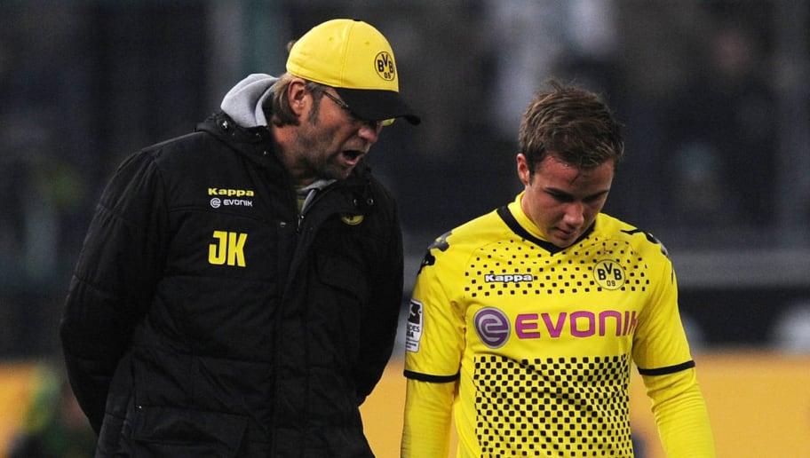 Dortmund's head coach Juergen Klopp (L)