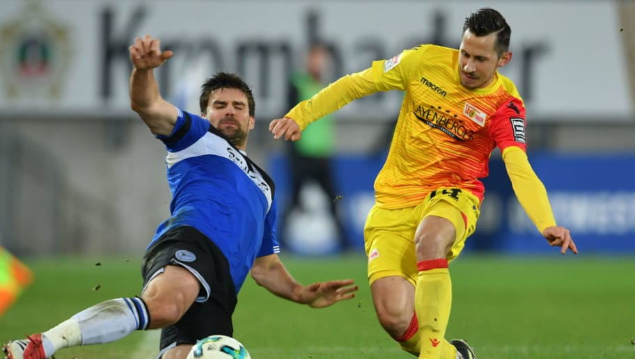 BIELEFELD, GERMANY - FEBRUARY 05: Steven Skrzybski (R) of Berlin and Florian Dick of Bielefeld fight for the ball during the Second Bundesliga match between DSC Arminia Bielefeld and 1. FC Union Berlin at Schueco Arena on February 5, 2018 in Bielefeld, Germany. (Photo by Thomas Starke/Bongarts/Getty Images)