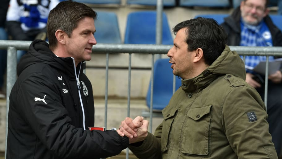 BIELEFELD, GERMANY - APRIL 01: Sports directors Ralf Becker (L) of Kiel and Samir Arabi of Bielefeld shake hands prior to the Second Bundesliga match between DSC Arminia Bielefeld and Holstein Kiel at Schueco Arena on April 1, 2018 in Bielefeld, Germany. (Photo by Thomas Starke/Bongarts/Getty Images)