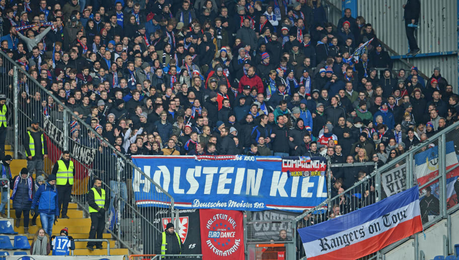BIELEFELD, GERMANY - APRIL 01: Supporters of Kiel cheer their team during the Second Bundesliga match between DSC Arminia Bielefeld and Holstein Kiel at Schueco Arena on April 1, 2018 in Bielefeld, Germany. (Photo by Thomas Starke/Bongarts/Getty Images)