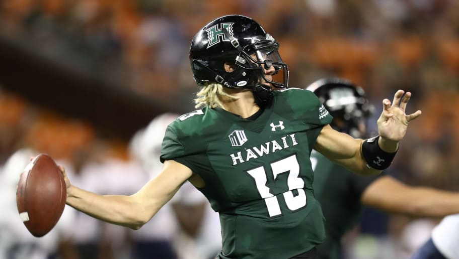 HONOLULU, HI - SEPTEMBER 22: Cole McDonald #13 of the Hawaii Rainbow Warriors fires a pass downfield during the third quarter of the game against the Duquesne Dukes at Aloha Stadium on September 22, 2018 in Honolulu, Hawaii. (Photo by Darryl Oumi/Getty Images)