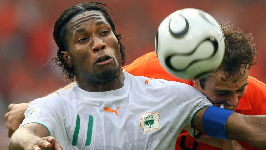 Stuttgart, GERMANY:  Dutch defender Joris Mathijsen (R) clashes with Ivorian forward Didier Drogba (L) in their opening round Group C World Cup football match at Stuttgart's Gottlieb-Daimler Stadium, 16 June 2006.  The Netherlands were leading 2-1 during the second half.         AFP PHOTO / VALERY HACHE  (Photo credit should read VALERY HACHE/AFP/Getty Images)