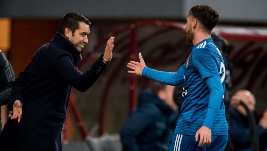(L-R) trainer coach Giovanni van Bronckhorst, Orkun Kokcu of Feyenoord scores at his debut, 1-3 during the Dutch Eredivisie match between FC Emmen and Feyenoord Rotterdam at De Oude Meerdijk on December 09, 2018 in Emmen, The Netherlands(Photo by VI Images via Getty Images)