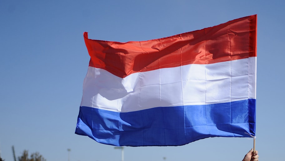 Dutch  fans with a national flag arrive