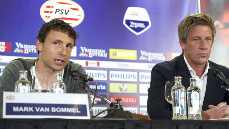 Dutch football player Mark van Bommel (L) speaks next to PSV's technical manager Marcel Brands during a press conference of the PSV Eindhoven, on May 14, 2012 after he signed a one year contract with the club, in Eindhoven.    AFP PHOTO/ ANP/ MARCEL VAN HOORN    ***NETHERLANDS OUT***        (Photo credit should read MARCEL VAN HOORN/AFP/GettyImages)