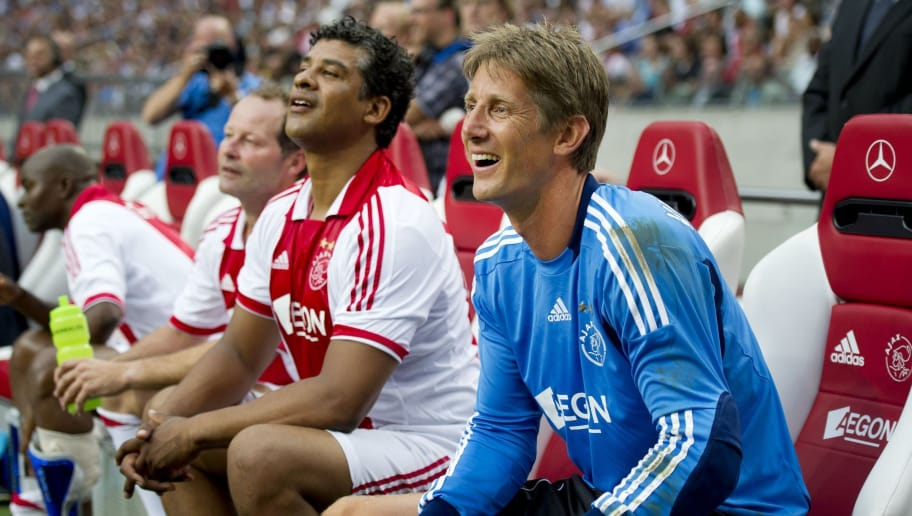 Dutch goalkeeper Edwin van der Sar (R) sits beside Frank Rijkaard in a full ArenA during his farewell match Ajax '95 against Oranje '98 in Amsterdam on August 3, 2011. Manchester United's former Dutch goalkeeper Edwin van der Sar bid farewell to his adoring public on Wednesday in the company of several star internationals in front of 53,000 Ajax fans. AFP PHOTO / ANP - OLAF KRAAK = netherlands out - belgium out (Photo credit should read OLAF KRAAK/AFP/Getty Images)