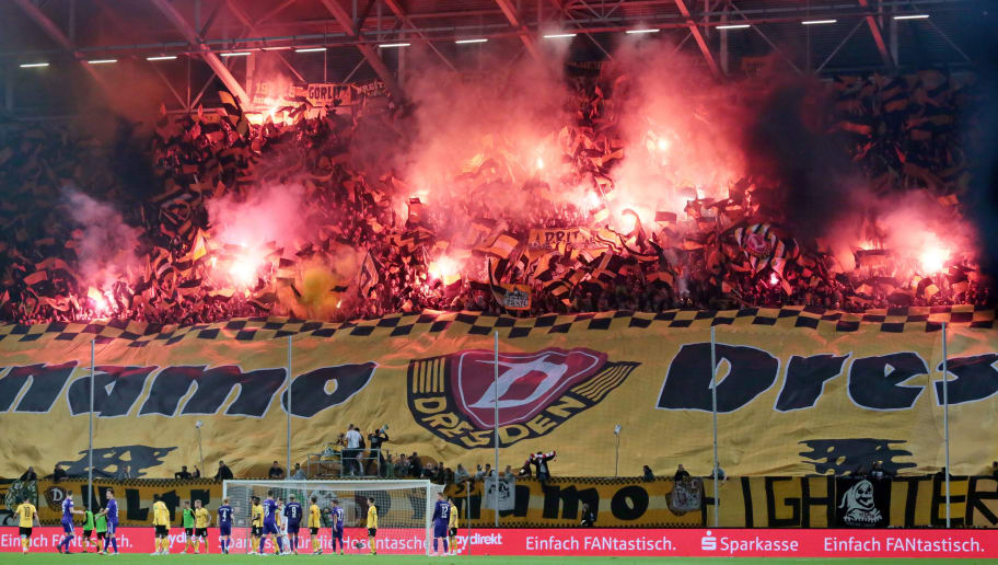 DRESDEN, GERMANY - OCTOBER 19: Supporters of Dynamo Dresden are firing Bengalos during the second Bundesliga match between Dynamo Dresden and Erzgebirge Aue on October 19, 2018 in Dresden, Germany. (Photo by TF-Images/Getty Images)