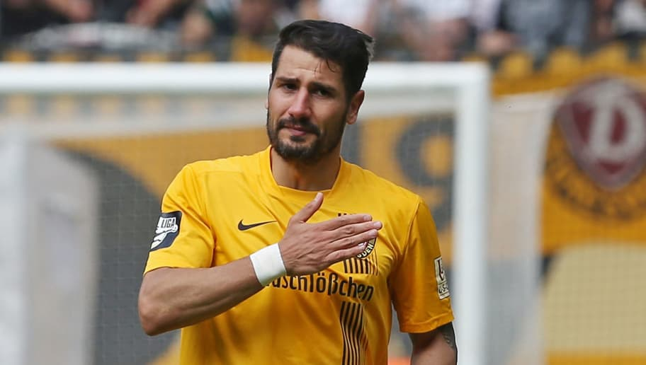 DRESDEN, GERMANY - MAY 23:  Cristian Fiel of Dresden thanks his supporters after his last third league match between SG Dynamo Dresden and FC Hansa Rostock at Gluecksgas-Stadion on May 23, 2015 in Dresden, Germany.  (Photo by Matthias Kern/Bongarts/Getty Images)