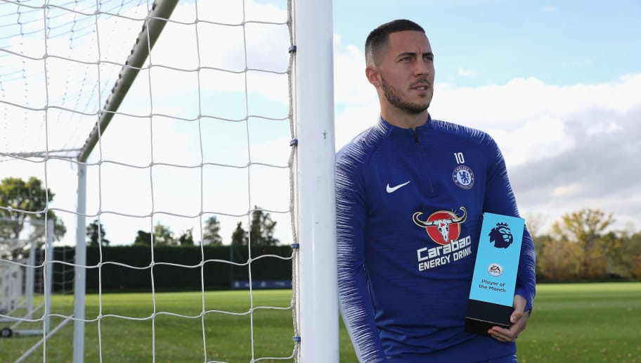 COBHAM, ENGLAND - OCTOBER 18:  Eden Hazard of Chelsea poses with his EA Sports Player of the Month Award for September 2018 at Chelsea Training Ground on October 18, 2018 in Cobham, England.  (Photo by Christopher Lee/Getty Images)