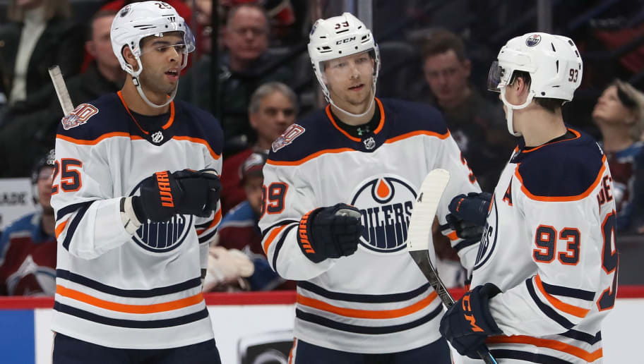 DENVER, COLORADO - DECEMBER 11: Darnell Nurse #25,  Alex Chiasson #39 and Ryan Nugent-Hopkins #93 of the Edmonton Oilers celebrate Nurse's goal against the Colorado Avalanche in the third period at the Pepsi Center on December 11, 2018 in Denver, Colorado. (Photo by Matthew Stockman/Getty Images)