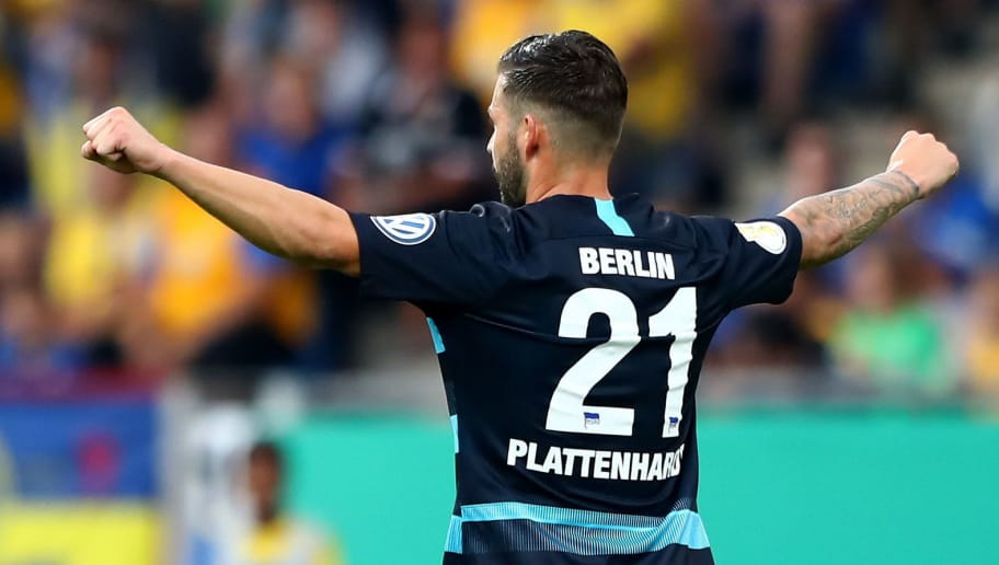 BRAUNSCHWEIG, GERMANY - AUGUST 20:  Marvin Plattenhardt #21 of Berlin celebrates after he scores the opening goal during the DFB Cup first round match between Eintracht Braunschweig and Hertha BSC at Eintracht Stadion on August 20, 2018 in Braunschweig, Germany.  (Photo by Martin Rose/Bongarts/Getty Images)