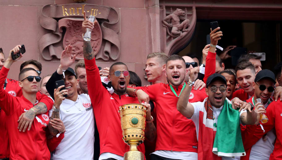 FRANKFURT AM MAIN, GERMANY - MAY 20: The team of Frankfurt with Kevin-Prince Boateng Ante Rebic celebrates winning the German Cup at the Roemer on May 20, 2018 in Frankfurt am Main, Germany. (Photo by Christof Koepsel/Bongarts/Getty Images)