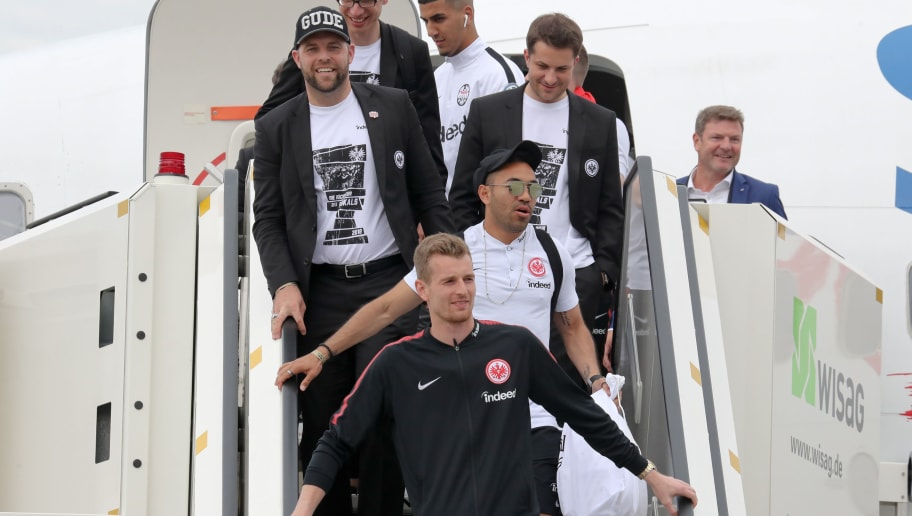 FRANKFURT AM MAIN, GERMANY - MAY 20: players of Eintracht Franfkurt as he departs the plane carrying the team of Eintracht Frankfurt during the arrival at Frankfurt International Airport on May 20, 2018 in Frankfurt am Main, Germany. (Photo by Andreas Schlichter/Bongarts/Getty Images)