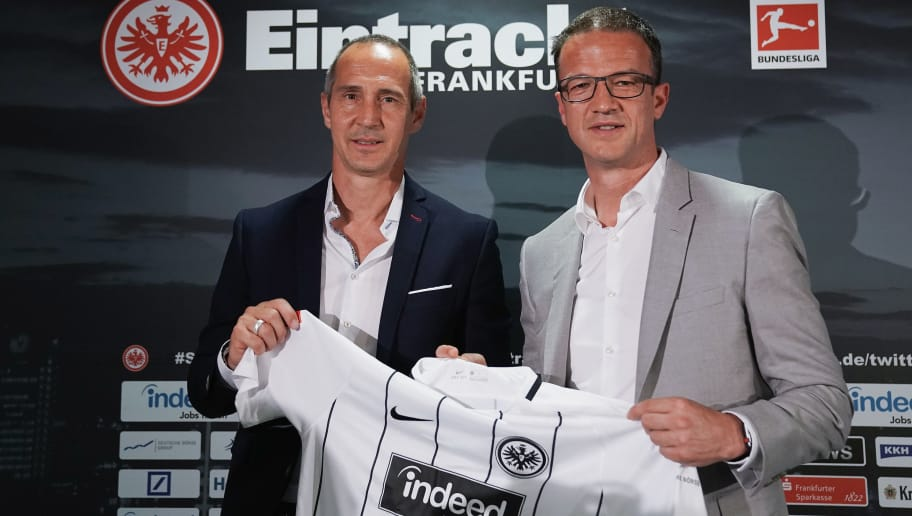FRANKFURT AM MAIN, GERMANY - MAY 30:  Adi Huetter poses with Fredi Bobic during his presentation as new head coach of Eintracht Frankfurt at Commerzbank-Arena on May 30, 2018 in Frankfurt am Main, Germany.  (Photo by Alex Grimm/Bongarts/Getty Images)