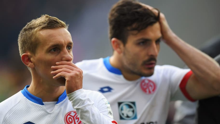 FRANKFURT AM MAIN, GERMANY - APRIL 24: Pablo de Blasis (L) and Giulio Donati of Mainz react after the Bundesliga match between Eintracht Frankfurt and 1. FSV Mainz 05 at Commerzbank-Arena on April 24, 2016 in Frankfurt am Main, Germany.  (Photo by Matthias Hangst/Bongarts/Getty Images)