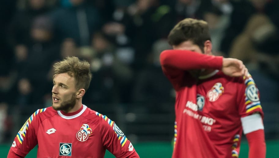 FRANKFURT AM MAIN, GERMANY - FEBRUARY 07: Alexandru Maxim of Mainz and Stefan Bell of Mainz look dejected after the DFB Cup match between Eintracht Frankfurt and 1. FSV Mainz 05 at Commerzbank-Arena on February 7, 2018 in Frankfurt am Main, Germany. (Photo by TF-Images/Getty Images)