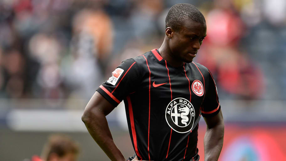 FRANKFURT AM MAIN, HESSE - APRIL 09:  Constant Djakpa of Eintracht Frankfurt looks dejected after the Bundesliga match between Eintracht Frankfurt and 1899 Hoffenheim at Commerzbank-Arena on April 9, 2016 in Frankfurt am Main, Germany.  (Photo by Dennis Grombkowski/Bongarts/Getty Images)