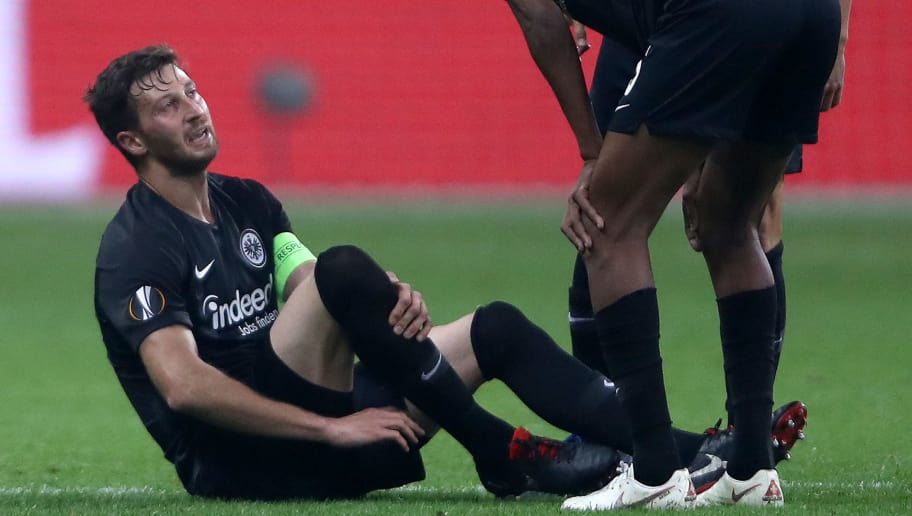 FRANKFURT AM MAIN, GERMANY - OCTOBER 25:  David Abraham of Eintracht Frankfurt reacts to an injury during the UEFA Europa League Group H match between Eintracht Frankfurt and Apollon Limassol at Commerzbank-Arena on October 25, 2018 in Frankfurt am Main, Germany.  (Photo by Alex Grimm/Bongarts/Getty Images)