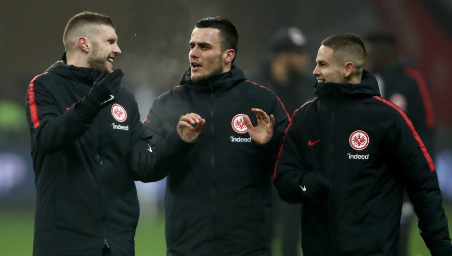 FRANKFURT AM MAIN, GERMANY - DECEMBER 16: (L-R) Ante Rebic, Filip Kostic and Mijat Gacinovic of Frankfurt celebrate after the Bundesliga match between Eintracht Frankfurt and Bayer 04 Leverkusen at Commerzbank-Arena on December 16, 2018 in Frankfurt am Main, Germany.  (Photo by Alex Grimm/Bongarts/Getty Images)