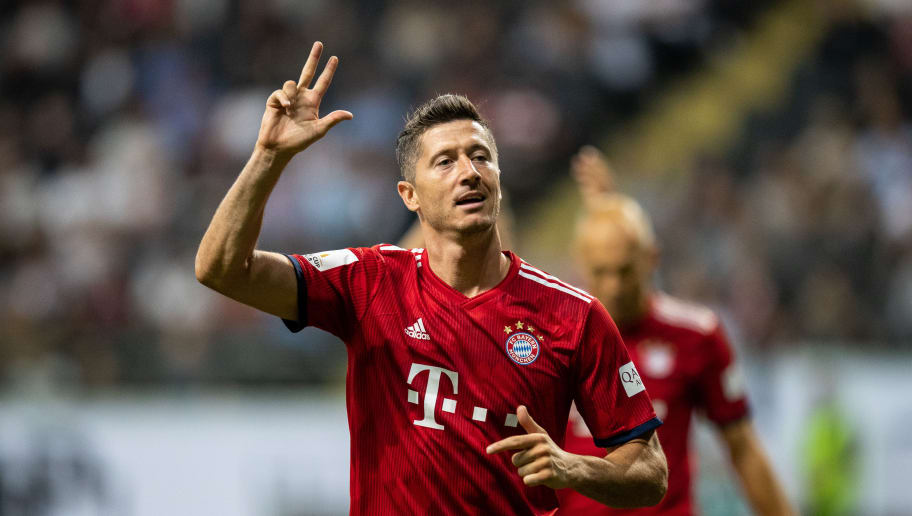 FRANKFURT AM MAIN, GERMANY - AUGUST 12:  Robert Lewandowski of FC Bayern Muenchen celebrates by showing three fingers after scoring his third goal during the DFL Supercup 2018 match between Eintracht Frankfurt and Bayern Muenchen at Commerzbank-Arena on August 12, 2018 in Frankfurt am Main, Germany.  (Photo by Boris Streubel/Getty Images)