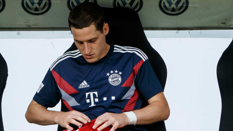 FRANKFURT AM MAIN, GERMANY - AUGUST 12: Sebastian Rudy of Bayern Muenchen sits on the bench prior to the DFL Supercup match between Eintracht Frankfurt and Bayern Muenchen at Commerzbank-Arena on August 12, 2018 in Frankfurt am Main, Germany. (Photo by TF-Images/Getty Images)